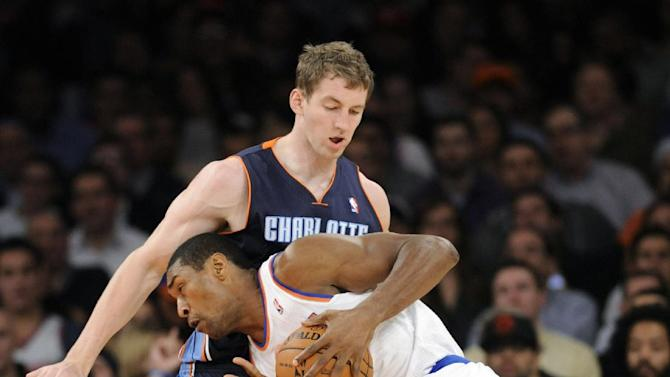 New York Knicks' Metta World Peace runs into Charlotte Bobcats' Cody Zeller during the third quarter of an NBA basketball game Tuesday, Nov. 5, 2013, at Madison Square Garden in New York. The Bobcats defeated the Knicks 102-97