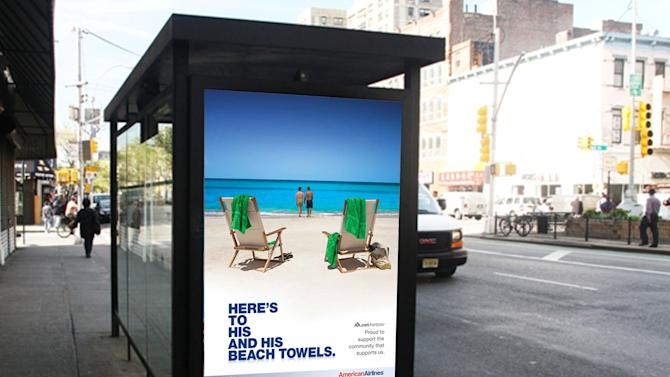"This 2010 image released by American Airlines shows a travel ad for American Airlines showing two men on a beach displayed at a bus stop shelter in New York.  The slogan reads, ""Here's to his and his beach towels."" and follows with, ""Proud to support the community that supports us."" Welcome to the latest in gay imagery in mainstream advertising, where LGBT people have been waiting for a larger helping of fairness and accuracy, on screen and in print, or at least something other than punchlines and cliches to sell stuff at their expense. (AP Photo/American Airlines)"