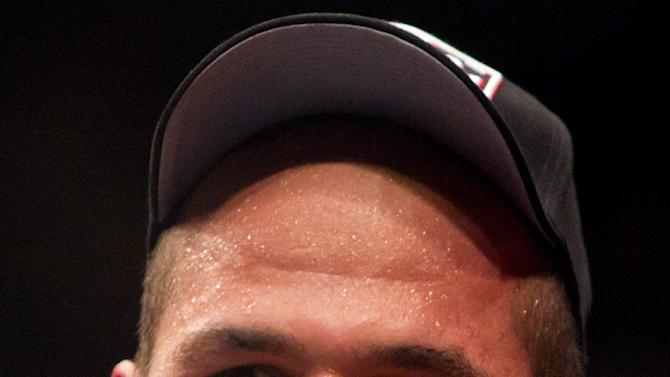 Junior Dos Santos, of Brazil, smiles after defeating Shane Carwin, of Greeley, Colo., in the main event heavyweight bout at UFC 131, Saturday, June 11, 2011, in Vancouver, British Columbia. (AP Photo/The Canadian Press, Darryl Dyck)