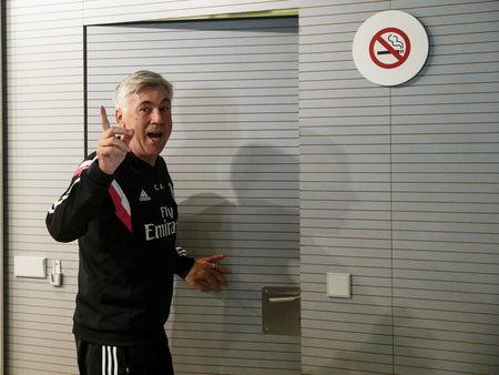 Real Madrid coach Carlo leaves after a news conference at Valdebebas, outside Madrid, Spain