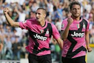 Juventus' Claudio Marechisio (R) celebrates with Giorgio Chiellini after he scored against Siena during their serie A football match at Artemio Franchi stadium in Siena. Juventus won 2-1
