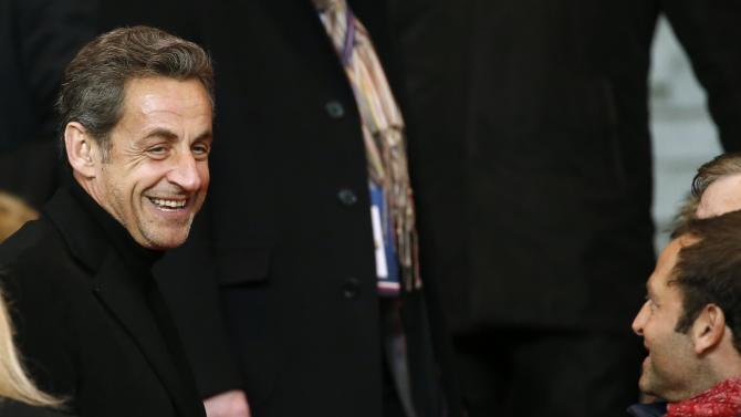 Former French President Nicolas Sarkozy arrives to attend the French Ligue 1 soccer match between Paris St Germain and St Etienne at the Parc des Princes Stadium in Paris