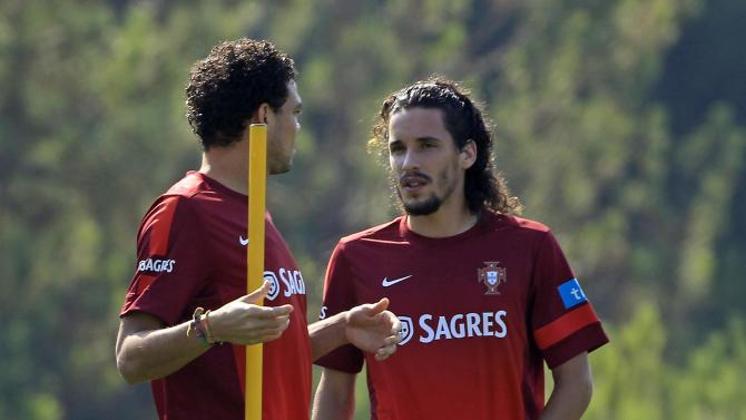 Portugal's national soccer team player Luis Carneiro talks to a teammate during a training session in Obidos