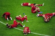 Bayern Munich players lie on the pitch after losing the Champions League final against Chelsea at the Allianz Arena in Munich on May 19. Chelsea beat Bayern Munich 4-3 on penalties after the game finished 1-1 after extra-time