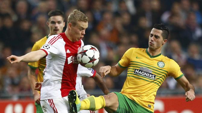 Celtic's Kayal tries to control the ball past Ajax Amsterdam's Sigthorsson during their Champions League soccer match at Amsterdam Arena