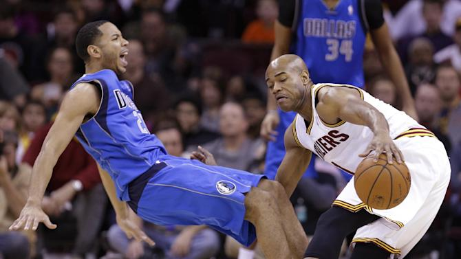 Cleveland Cavaliers' Jarrett Jack, right, fouls Dallas Mavericks' Devin Harris during the third quarter of an NBA basketball game Monday, Jan. 20, 2014, in Cleveland. Dallas defeated Cleveland 102-97