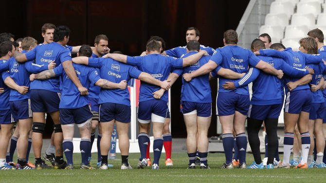 France's rugby team players huddle during a training session at the stade de France stadium, in Saint Denis, outside Paris, Friday, March 14, 2014. France will play Ireland during a Six Nations Rugby Union match on March 15. (AP Photo/Christophe Ena)