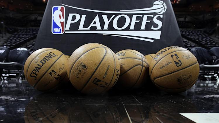 Basketballs sit on the court prior to Game 1 of the opening-round NBA basketball playoff series between the San Antonio Spurs and Dallas Mavericks, Sunday, April 20, 2014, in San Antonio