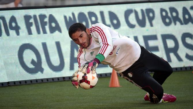 Mexico's Corona catches a ball during a training session for their 2014 World Cup qualifying playoff second leg soccer match against New Zealand in Wellington
