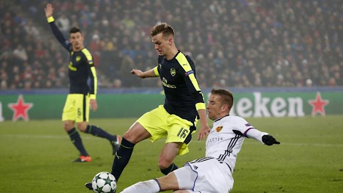 Arsenal's Rob Holding in action with FC Basel's Marc Janko