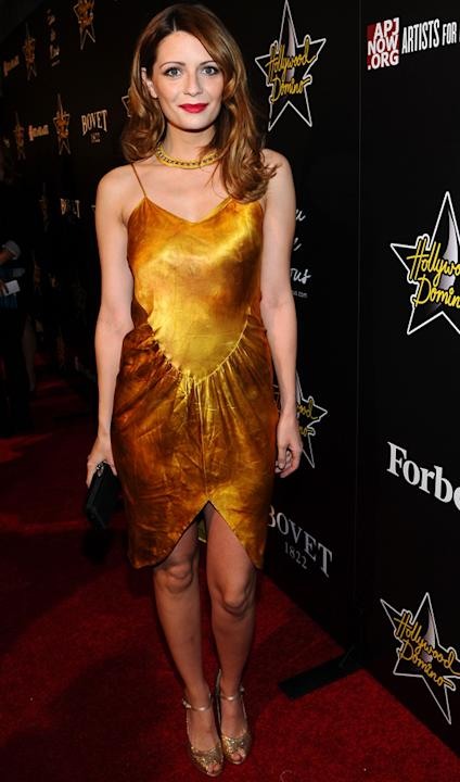 Celebrity fashion gold dresses: Mischa Barton looked beautiful in a burnt gold dress for a bash in Hollywood. She added an extra carat of class with a loose curls in her hair.