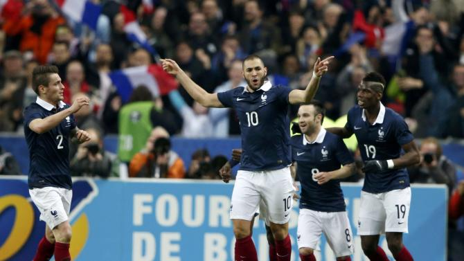 France's Benzema celebrates after scoring againts the Netherlands during their international friendly soccer match at the Stade de France in Saint-Denis