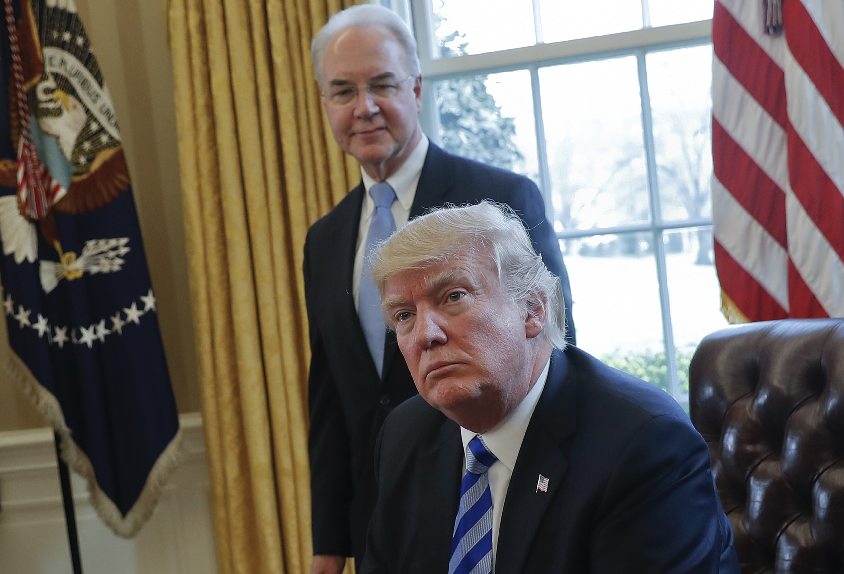 March 24, 2017, President Donald Trump with Health and Human Services Secretary Tom Price in the Oval Office (AP Photo/Pablo Martinez Monsivais)
