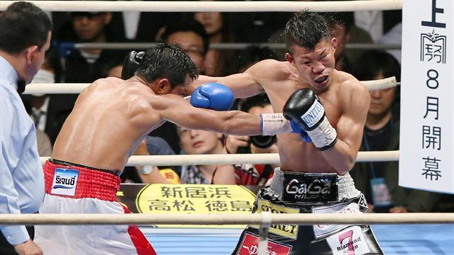 Boxing - Kameda hangs on to title in Osaka
