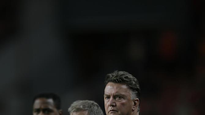Netherlands' Louis van Gaal, right, and assistant coach Patrick Kluivert, left, watch their players warm up prior to the Group D World Cup qualifying soccer match between Netherlands and Hungary, at ArenA stadium in Amsterdam, Netherlands, Friday Oct. 11, 2013. The Netherlands won the match with a 8-1 score