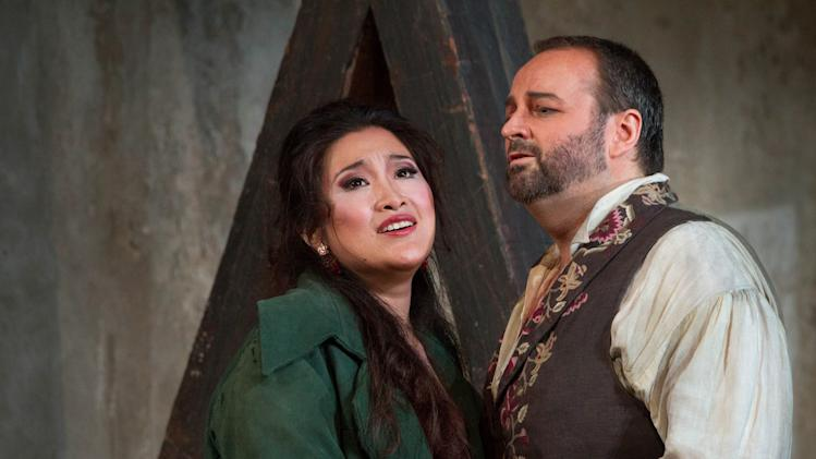 "In this photo Sept. 27, 2012 provided by the Metropolitan Opera, Guanqun Yu performs the role of Lenora and Gwyn Hughes-Jones performs the role of Manrico during a dress rehearsal of Verdi's ""Il Trovatore,"" at the Metropolitan Opera in New York. (AP Photo/Metropolitan Opera, Marty Sohl)"