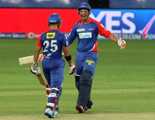Delhi Daredevils batsmen JP Duminy and Nathan Coulter-Nile celebrates after wining the match against Kolkata Knight Riders at Dubai International Cricket Stadium on April 19, 2014. (Photo: IANS)