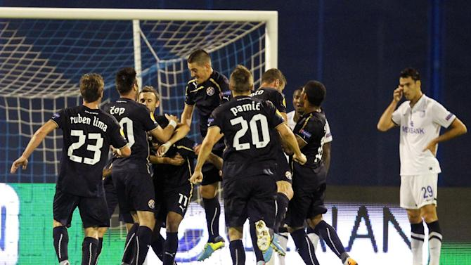 Dinamo Zagreb players celebrate first goal against Chornomorets Odessa during their Europa League  group B soccer  match,   in Zagreb, Croatia, Thursday, Sept. 19, 2013