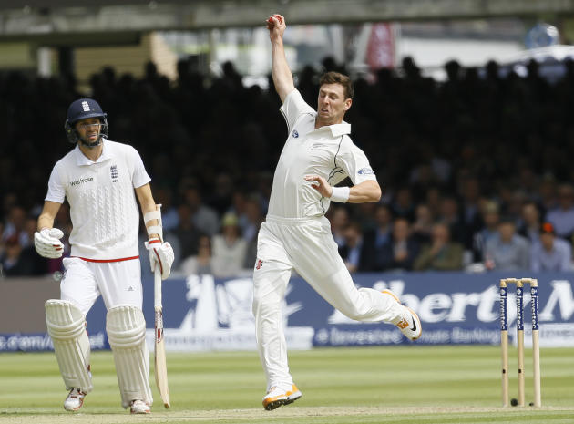New Zealand's Matt Henry catches off his own bowling England's James Anderson to close the England 1st inning at 389, during play on the second day of the first Test match at Lord's cricke
