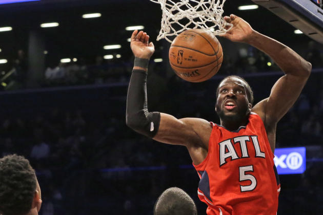 FILE - In this April 25, 2015, file photo, Atlanta Hawks forward DeMarre Carroll dunks during the second half in Game 3 of a first-round NBA basketball playoff series against the Brooklyn Nets, in New