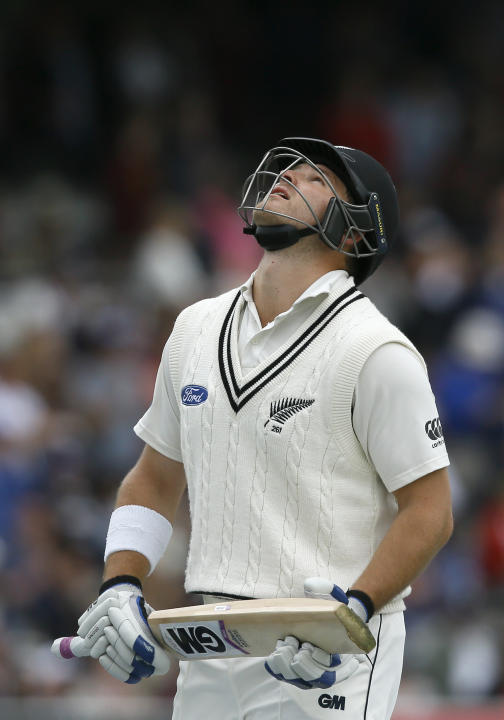 New Zealand's Corey Anderson leaves the pitch after being bowled lbw by England's Joe Root during the fifth day of the first Test match between England and New Zealand at Lord's cricket gr
