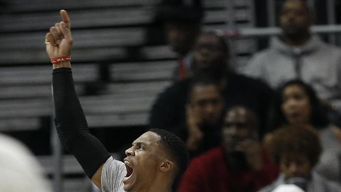 Oklahoma City Thunder guard Russell Westbrook (0) reacts from the bench after a basket in the first half of an NBA basketball game against the Atlanta Hawks Monday, Dec. 5, 2016, in Atlanta. (AP Photo/John Bazemore)