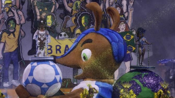 The official mascot of the FIFA 2014 World Cup, Fuleco the Armadillo, is seen on a float of Leandro de Itaquera samba school during the first night of the Special Group category of the annual Carnival parade in Sao Paulo's Sambadrome
