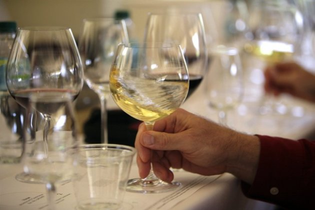 In this May 20, 2009 file photo a glass of white wine is swirled during a tasting in Oakville, Calif. (AP Photo)