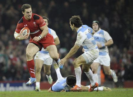 Wales' George North evades a tackle by Argentina's Nicolas Sanchez during their international rugby union match at the Millennium Stadium in Cardiff