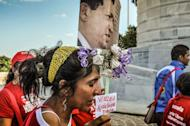 Cubans queue up at Revolution Square in Havana to attend the posthumous tribute to late Venezuelan President Hugo Chavez on March 7, 2013