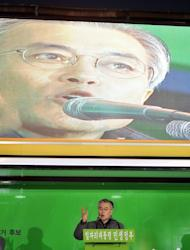 South Korean presidential candidate Moon Jae-In of the opposition Democratic United Party speaks at an election campaign rally in Seoul on December 15, 2012. South Korea's journey from war-torn poverty to Asia's fourth-largest economy has done little to break the male stranglehold on political and commercial power in what in many ways remains a very conservative nation