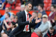 Manchester United's caretaker manager Ryan Giggs leaves the field at the end of an English Premier League football match against Sunderland at Old Trafford in Manchester, northwest England on May 3, 2014