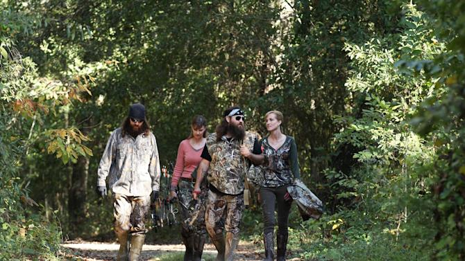"""This 2013 photo released by A&E Network shows, from left, Jase Robertson, Missy Robertson, Willie Robertson and Korie Robertson, in the episode """"Let's Go Hunting, Deer,"""" from the A&E Networks show, """"Duck Dynasty."""" The series star Willie Robertson will talk about his outspoken father, Phil Robertson, as he helps Fox News Channel ring in the new year. The network says Robertson and wife, Korie, will be guests on the """"All-American New Year"""" special Fox News is airing Tuesday night, Dec. 31, 2013. (AP Photo/A&E Network, Art Streiber)"""