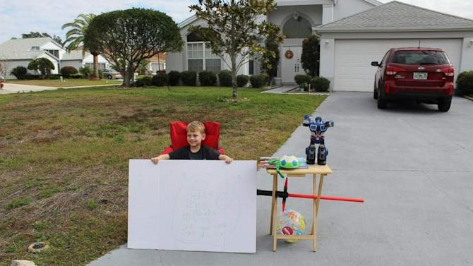 Boy Pays It Forward With 'Free Toy' Stand in Front Yard