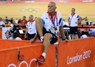 The British cycling team's head coach Shane Sutton watches a race during the London Olympics at the Velodrome in the Olympic Park in East London, August 5, 2012. Sutton suffered bleeding on the brain in a road accident on Thursday, the team said, just a day after Tour de France champion Bradley Wiggins was also injured in a crash