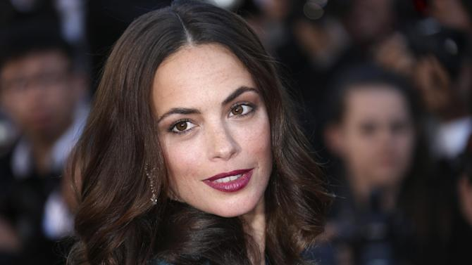 Actress Berenice Bejo poses for photographers as she arrives for the awards ceremony of the 66th international film festival, in Cannes, southern France, Sunday, May 26, 2013. (Photo by Joel Ryan/Invision/AP)