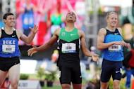 Ashton Eaton (C) celebrates after breaking the world record in the men's decathlon after competing in the 1,500m at the US Olympic Track and Field Team Trials on June 23