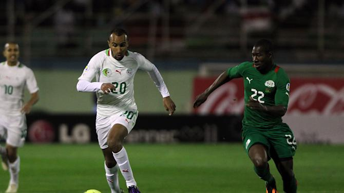 ALGIERS, Nov. 20, 2013 (Xinhua/IANS) -- Algeria's Nacreddine Khoualed (L) breaks through during the 2014 World Cup qualifying second leg playoff soccer match against Burkina Faso in Algiers, Algeria, on Nov. 19, 2013. Algeria won 1-0 and qualified for the final stage of 2014 World Cup. (Xinhua/Mohamed Kadri)
