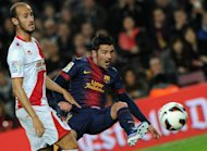 Barcelona forward David Villa (R) and Rayo Vallecano's Alex Galvez are pictured during their Spanish league match on March 17, 2013. Villa opened the scoring after teammate Lionel Messi had unlocked the Rayo defence on 25 minutes