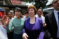 "Myanmar's pro-democracy leader Aung San Suu Kyi (left) walks with EU foreign policy chief Catherine Ashton in Yangon. Ashton urged Myanmar to make its progress towards democracy ""irreversible"" and called for an end to bloody ethnic conflict"