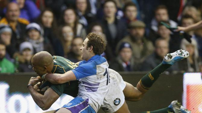 South Africa's Pietersen scores a try as Scotland's Jackson attempts to tackle during their rugby union match in Edinburgh