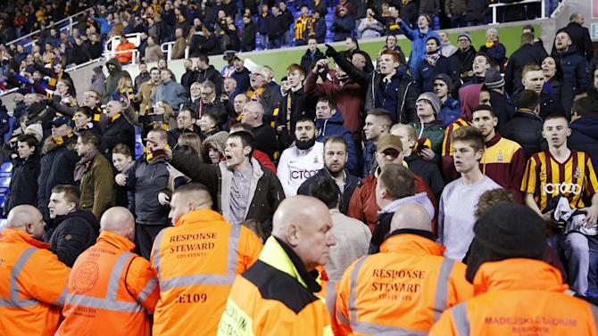 Football: Bradford City fans at the end as stewards look on