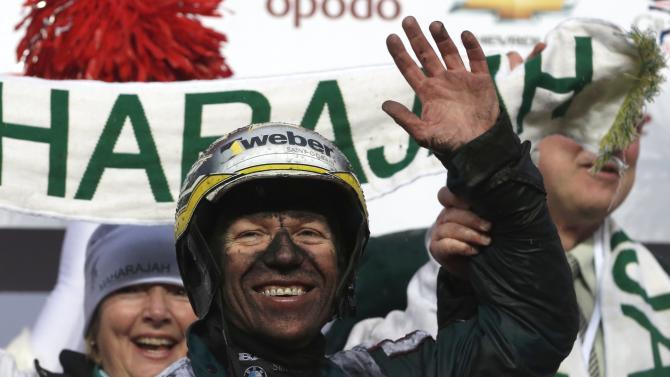 Kihlstrom reacts after winning the 93rd Prix d'Amerique Marionnaud trotting race at the Vincennes racetrack near Paris