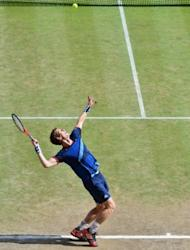 Andy Murray serves to Roger Federer during the Olympic men's singles final. Murray got his wish that the final would be staged with the Centre Court roof open as he felt his Wimbledon defeat was in part due to Federer thriving after a switch to indoor play