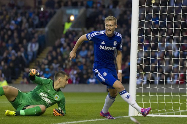 Chelsea's Andre Schurrle celebrates after scoring past Burnley goalkeeper Tom Heaton during their English Premier League soccer match at Turf Moor Stadium, Burnley, England, Monday Aug. 18, 2014. (AP Photo/Jon Super)
