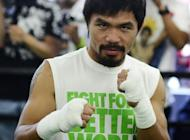 Filipino fight king Manny Pacquiao strikes a pose for the media at Wild Card Boxing Club in California on May 30. Pacquiao wants to deliver something special against Timothy Bradley on June 9, to erase the taste of his narrow victory over Juan Manuel Marquez in November