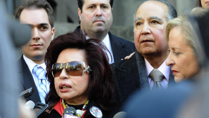 "FILE- In this March 8, 2011, file photo, Sylvia Cachay, mother of Sylvie Cachay, speaks to the media outside State Supreme court in New York as her husband Antonio Cachay, right, looks on. New York City fashion designer Sylvie Cachay was found dead on found Dec. 9, 2010, in a swanky hotel room's overflowing bathtub. Prosecutors say her boyfriend, Nicholas Brooks, the son of Joseph Brooks, an Oscar-winning composer who wrote ""You Light up My Life,"" strangled Cachay when she tried to end their relationship. (AP Photo/Louis Lanzano, File)"