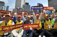 Thousands of South Korean taxi drivers stage a nationwide strike in Seoul on June 20, 2012. More than 200,000 taxi drivers demanded higher fares and cheaper fuel
