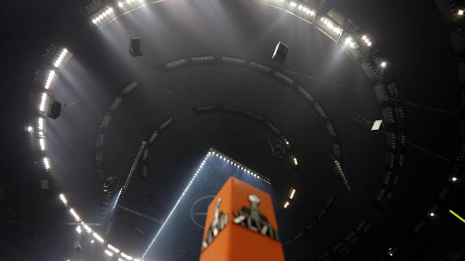 Half the lights are out in the Superdome during a power outage in the second half of the NFL Super Bowl XLVII football game between the San Francisco 49ers and Baltimore Ravens on Sunday, Feb. 3, 2013, in New Orleans. (AP Photo/Dave Martin)