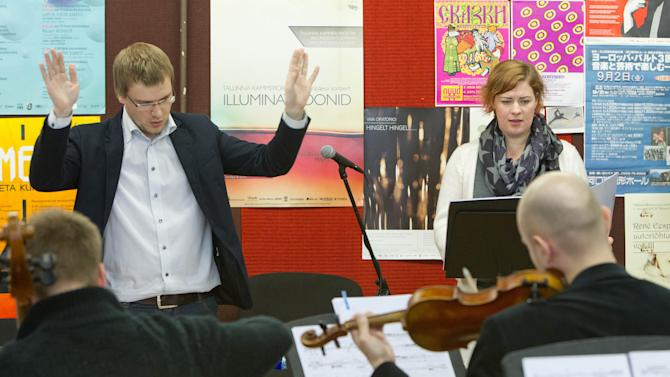 "Conductor Risto Joost, left, and soprano Iris Oja rehearse the operetta ""Nostra Culpa"" in Tallinn, Estonia, Thursday, April 4, 2013. Inspired by a lively social media exchange between Estonian President Toomas Hendrik Ilves and Nobel Prize-winning economist Paul Krugman, the two expats, composer Eugene Birman and Scott Diel, who wrote the lyrics, have composed an operetta that soars across the merits and pitfalls of austerity _ an ever more prominent reality in Europe's struggling economy. (AP Photo/Liis Treimann)"